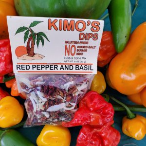 Kimo's Dips Red Pepper & Basil mix in bed of mixed peppers