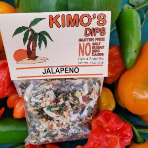 Kimo's Dips Jalapeño SSpice Mix in bed of mixed peppers